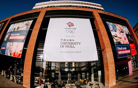 Three large banners that read 'Find Your Extraordinary' hang from the side of the Brynmor Jones Library, promoting Team GB's partnership with the University of Hull.