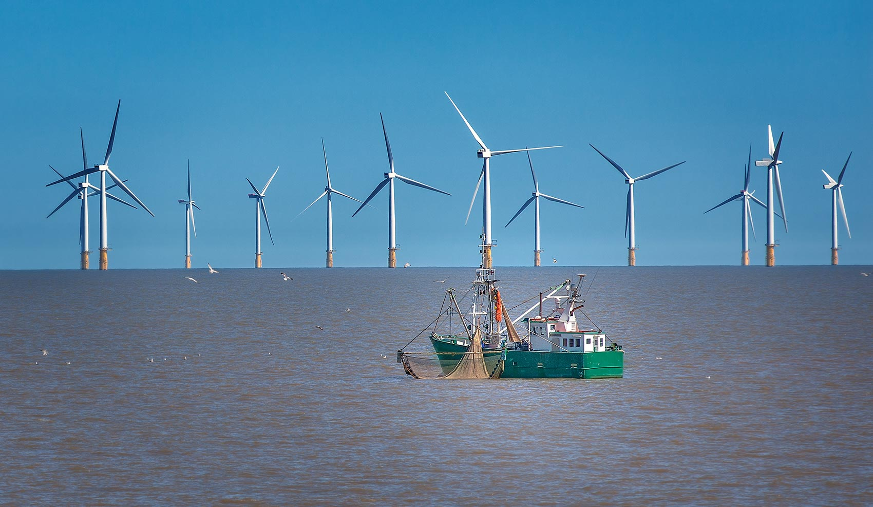 Ship in front of offshore wind farm