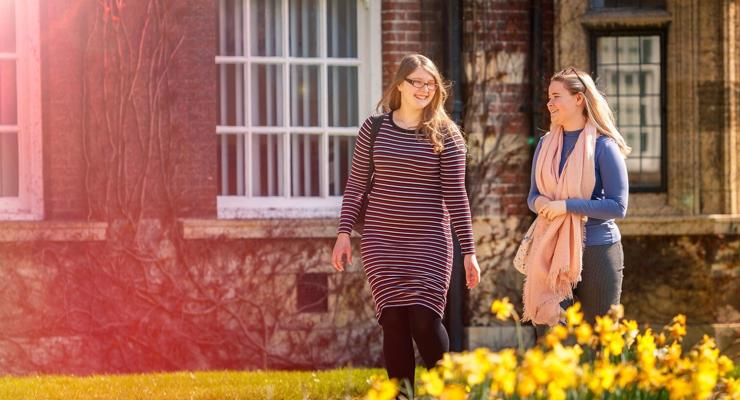 Postgraduate Rebecca Humphries & Georgia Sykes walking by HUBS Wharfe Building