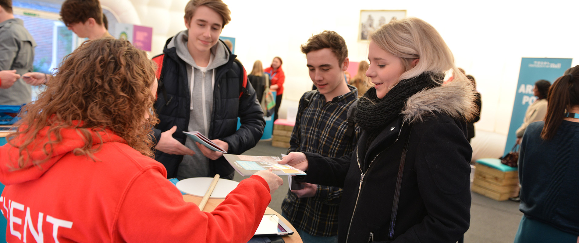Prospective students chatting to University staff at an Open Day