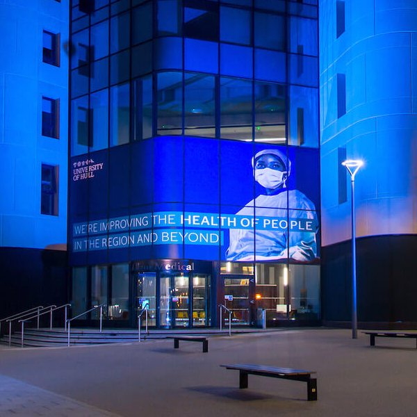 Allam Medical Building lit in blue